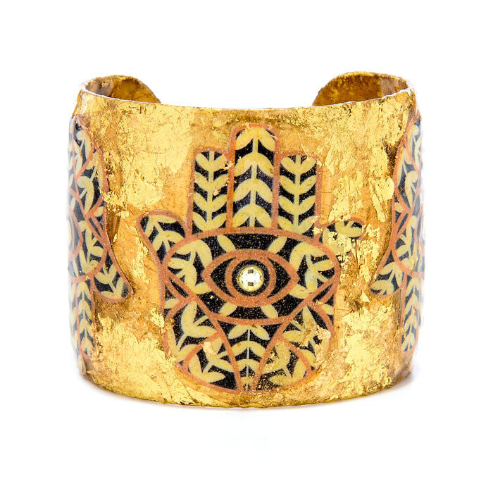 Beautiful Evocateur gold cuff adorned with Hamsas image, available at Patricia