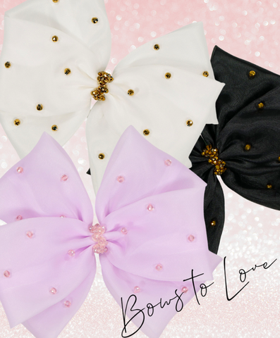 three big pastel colored bows for kids
