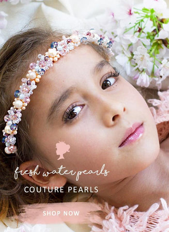 pretty flower girl wearing luxury pearl headpiece