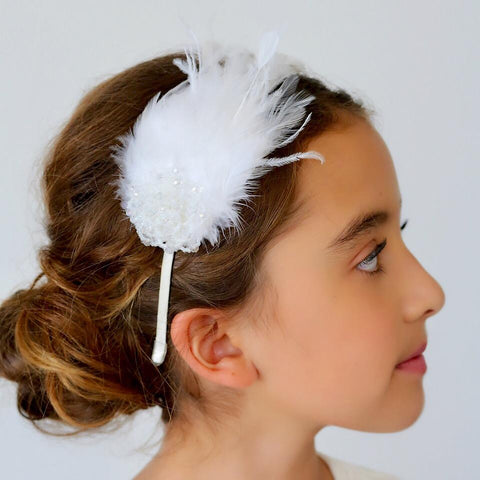 braided hairstyle for brides wearing white headband