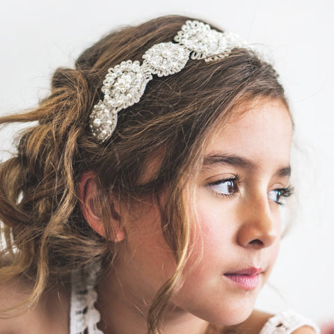 braided hairstyle for brides with luxury hair accessory