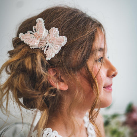 messy hair bun with cute pink clip for bride