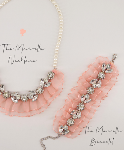 pink matching necklace and bracelet