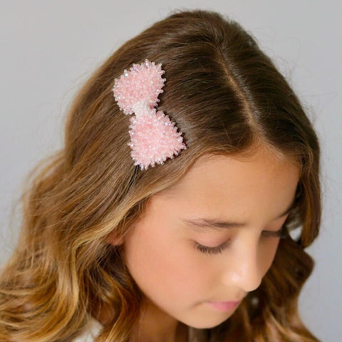 wavy hairstyle for brides with pink designer hair clip accessory