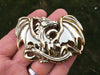 Brass Dragon Buckle in hand