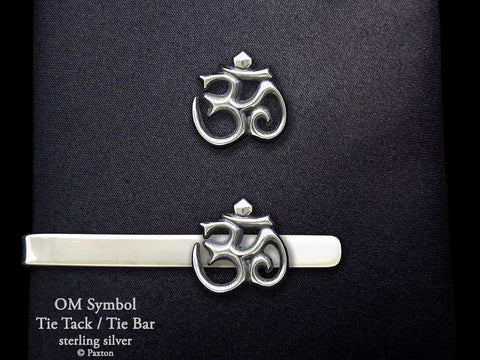 Om tie tack or tie bar shown on tie (front view)