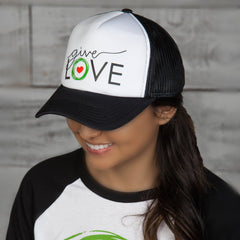 "Woman wearing black and white trucker cap with ""Give Love"" logo"