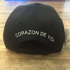 Black cap with Corazon de Vida embroidered on the back in white