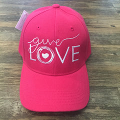 "Pink cap with ""give love"" embroidered on the front"