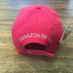 Pink 6 panel cap with Corazon de Vida embroidered on the back