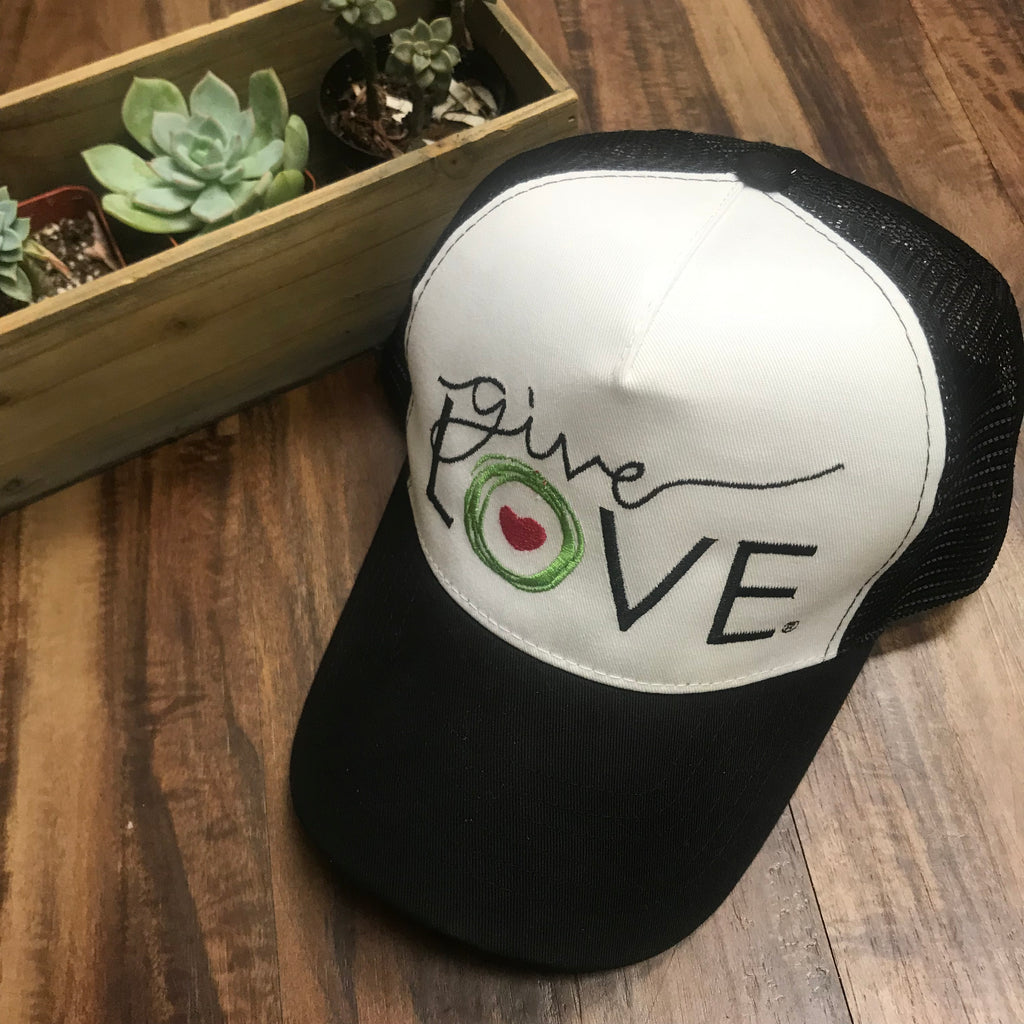 "Black and white trucker cap with ""Give Love"" logo"