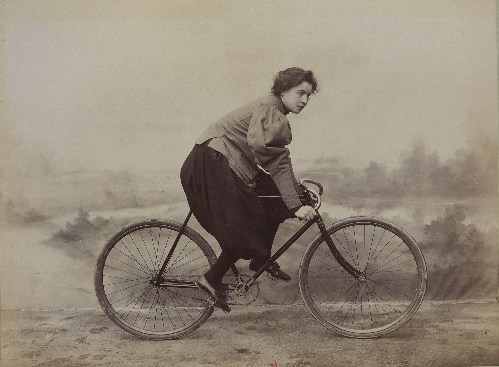 A historical photo of a French cyclist in bloomers.