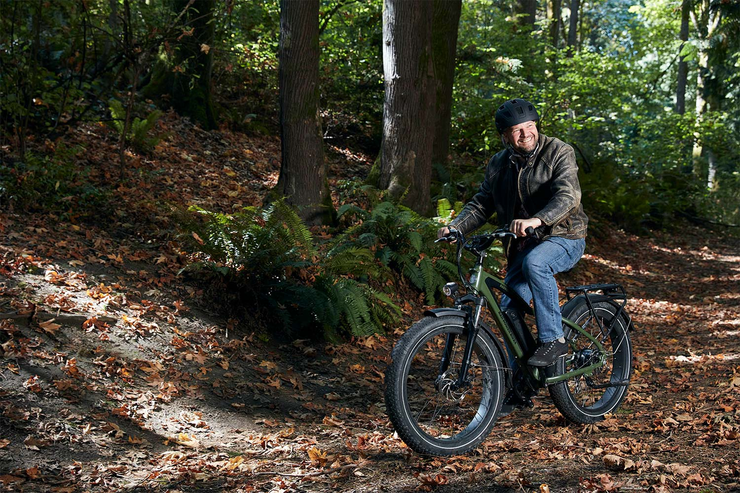 Man riding RadRover bike in the forest