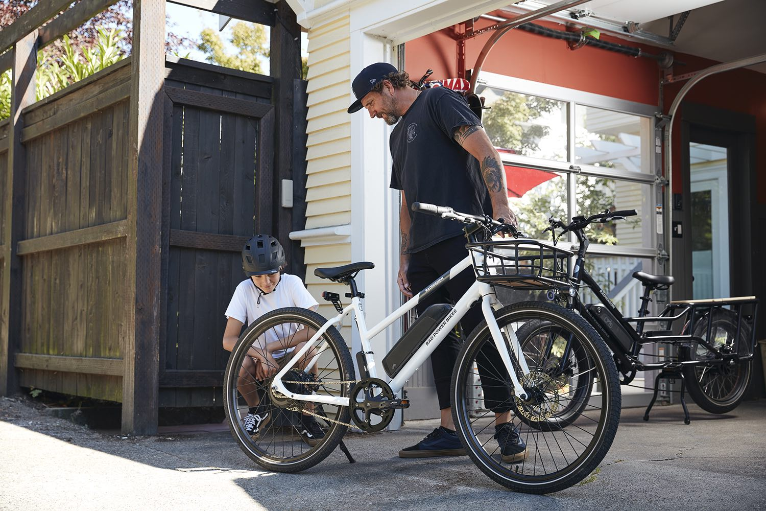 A father and son check out the RadWagon 4 from their driveway.