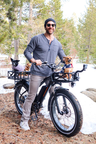 Pet adoption advocate Lee Asher on his RadRover. 3 dogs join him in his front and rear baskets.