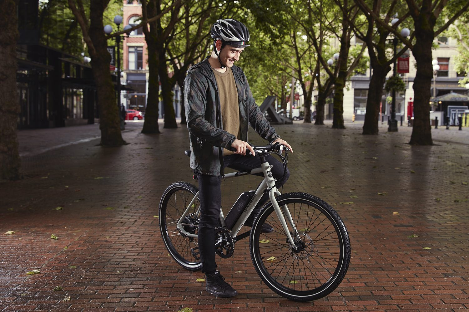 A man pauses in a plaza to admire his RadMission electric bike.