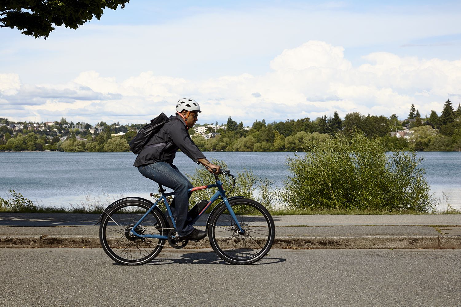 A man rides a RadMission along the waterfront.