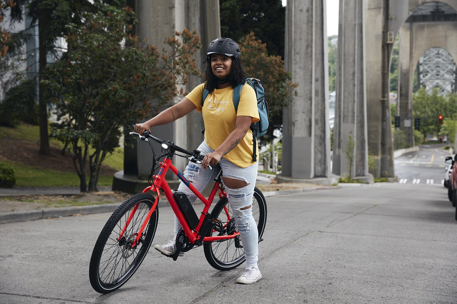 A woman rides her RadMission in Seattle.