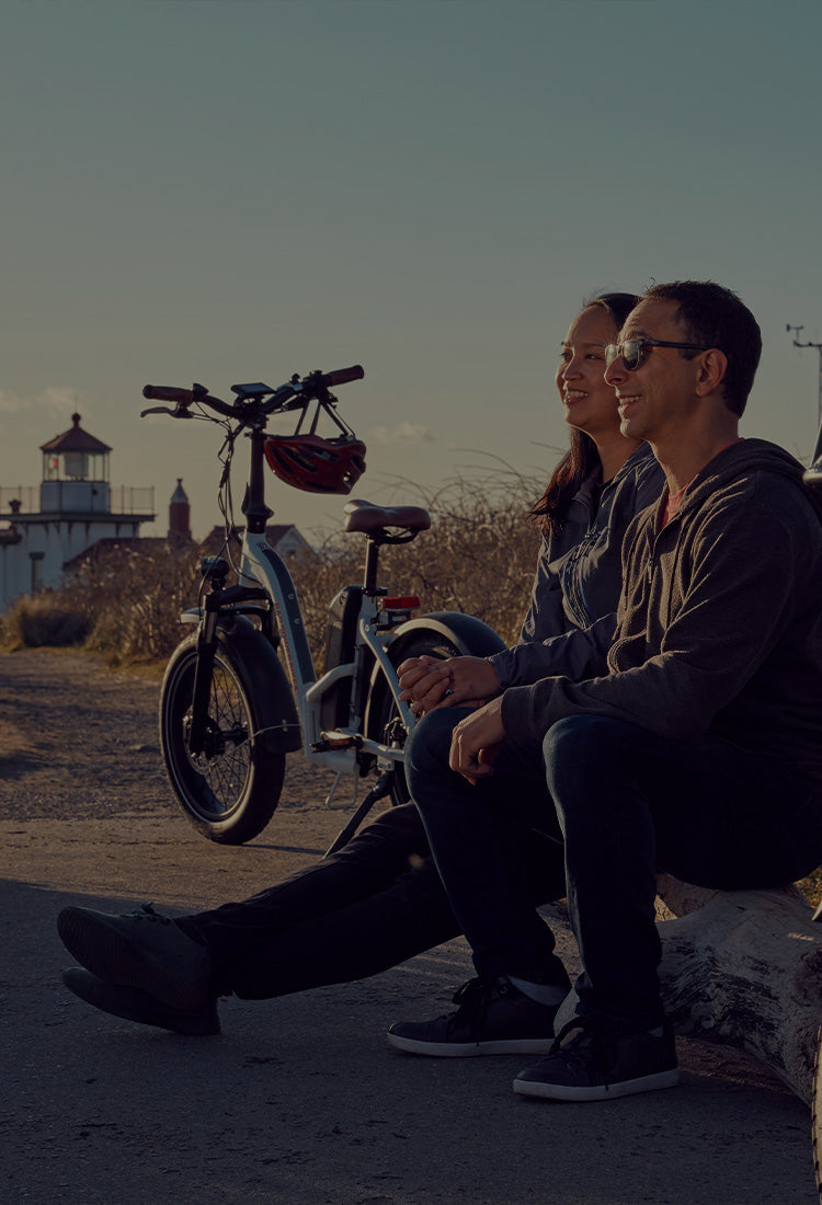 Couple at the beach with electric bikes