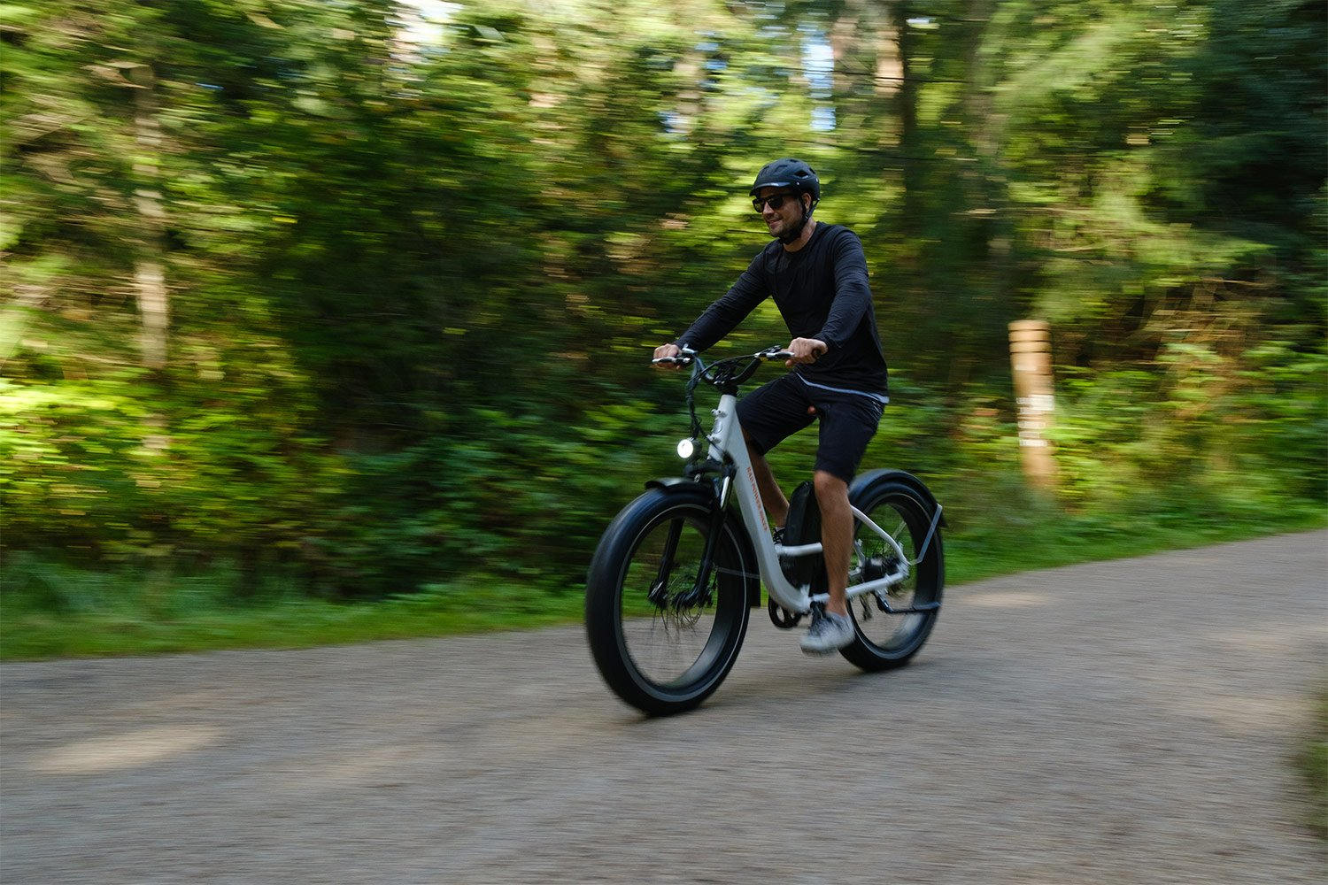 Man riding RadRover Step-Thru, which is class 2 electric bike
