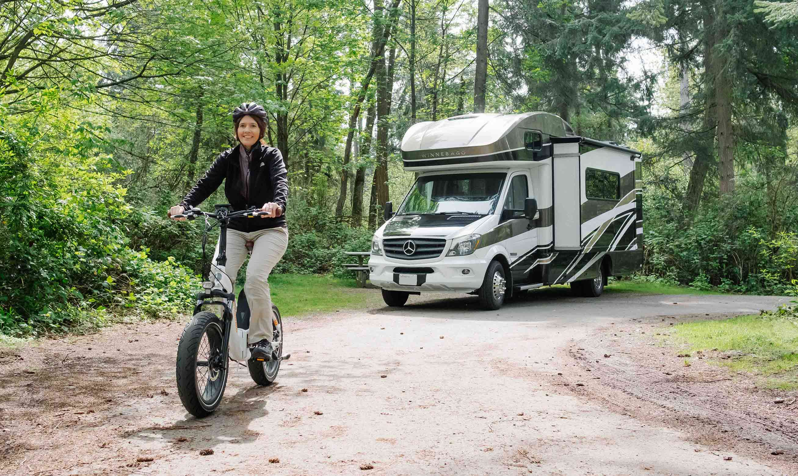 A woman rides away from her RV on a RadMini
