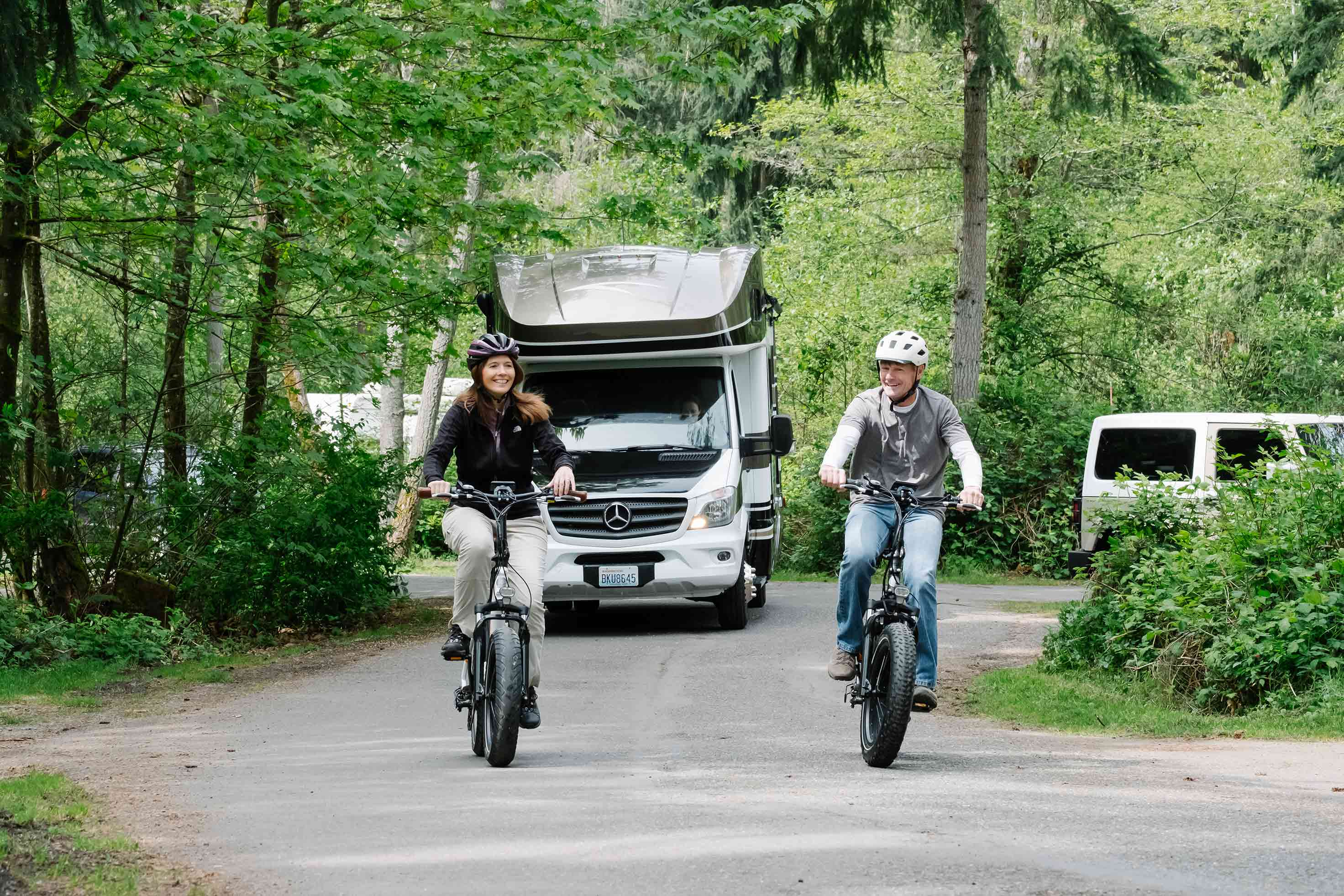 Two people load up a RadMini onto an RV.