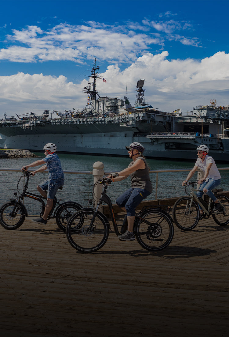 Three people riding electric bikes