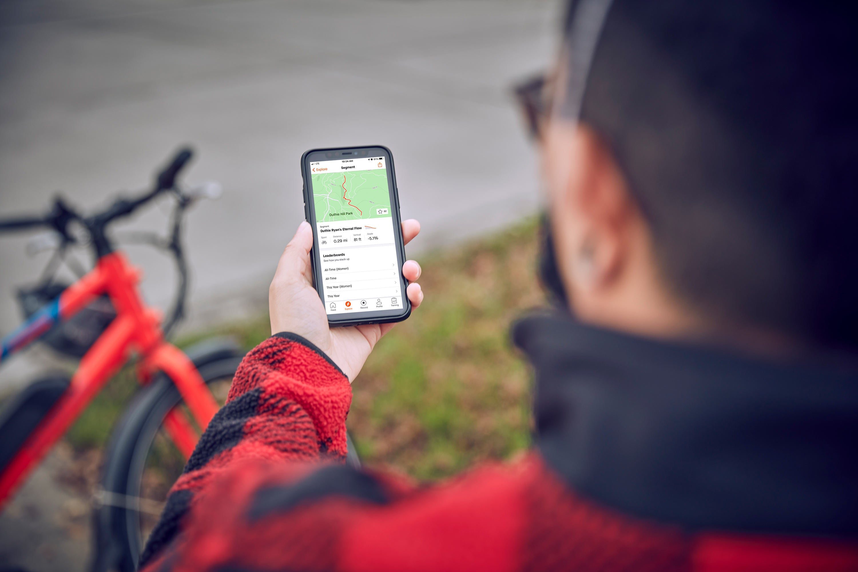 A Rad Power Bikes rider looks at his route on his phone.