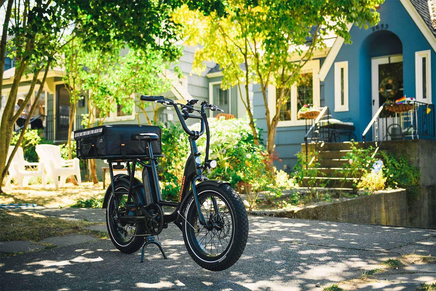 RadRunner e-bike parked in front of blue house
