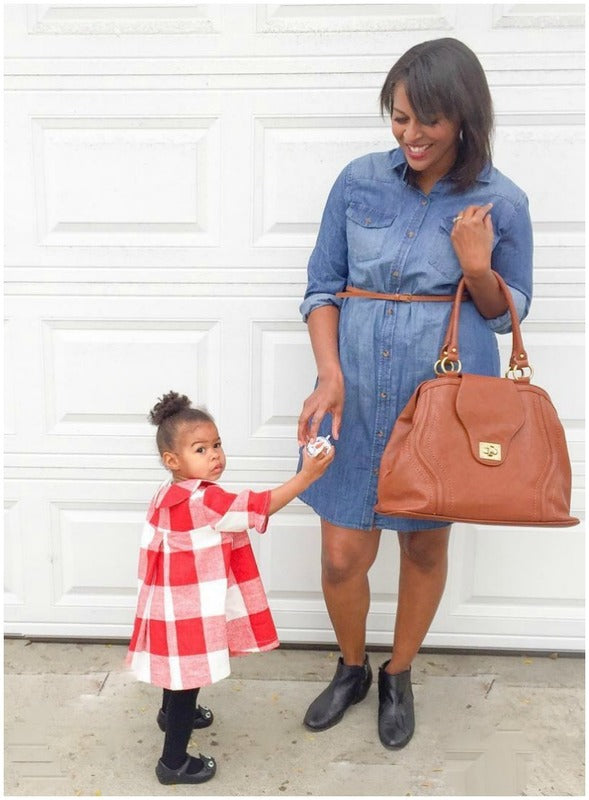 The Gail Satchel Diaper Bag in Sandalwood has a center divider pocket for extra organization.