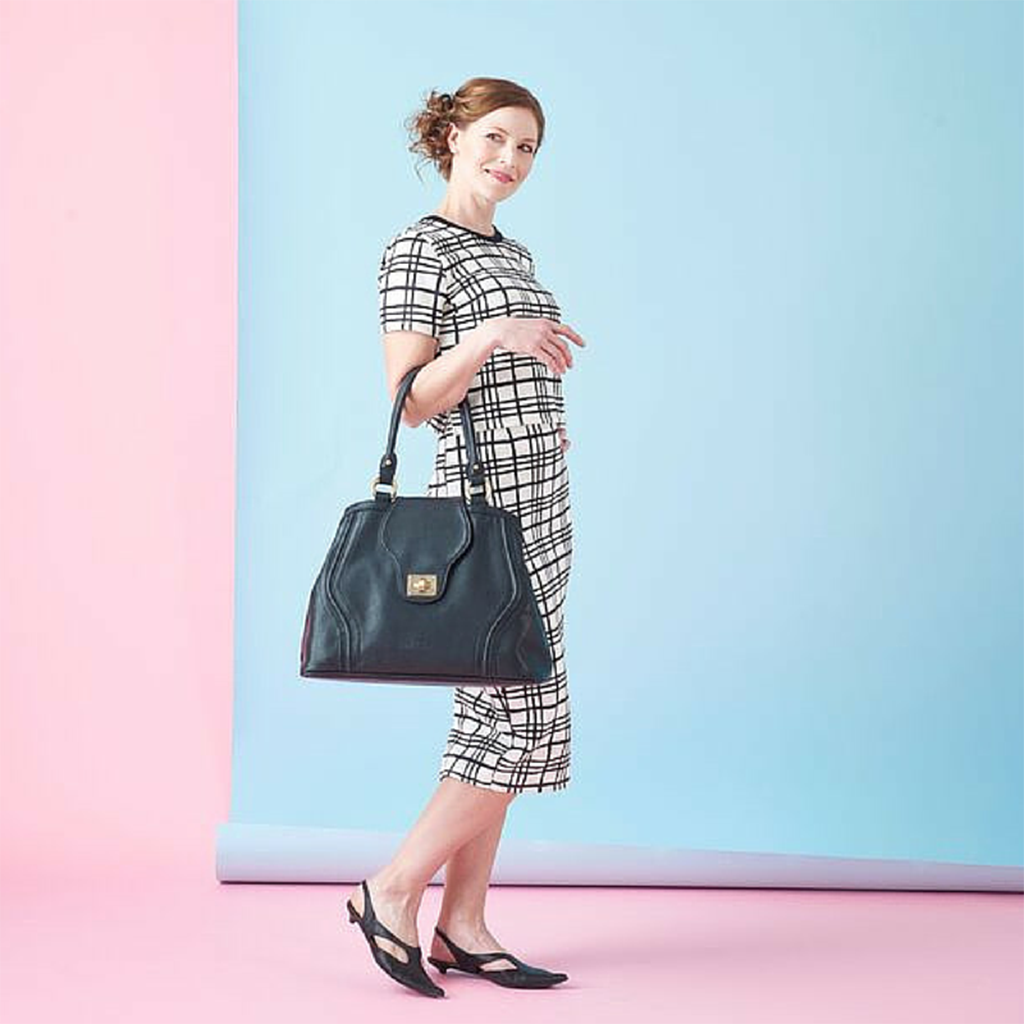 Don't let a Diaper Bag bring down your style. Our Gail Satchel in Black is smart and stylish.