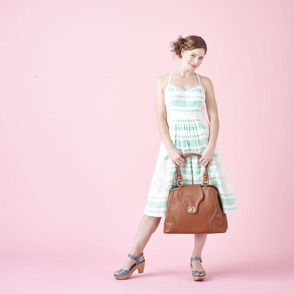 For the modern mom, the Gail Satchel Diaper Bag in Sandlewood is stylish and functional.