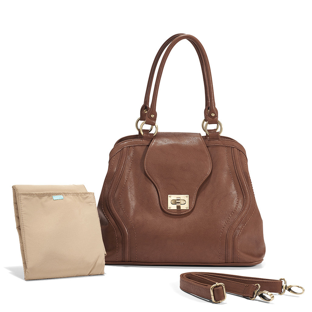 The Gail Satchel Diaper Bag in Sandlewood comes with an extra strap when you need a free hand.
