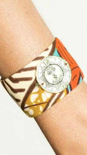 Tribal Cuff With Sun Logo