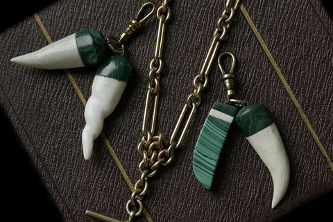 Malachite and Carved Bone Pendants
