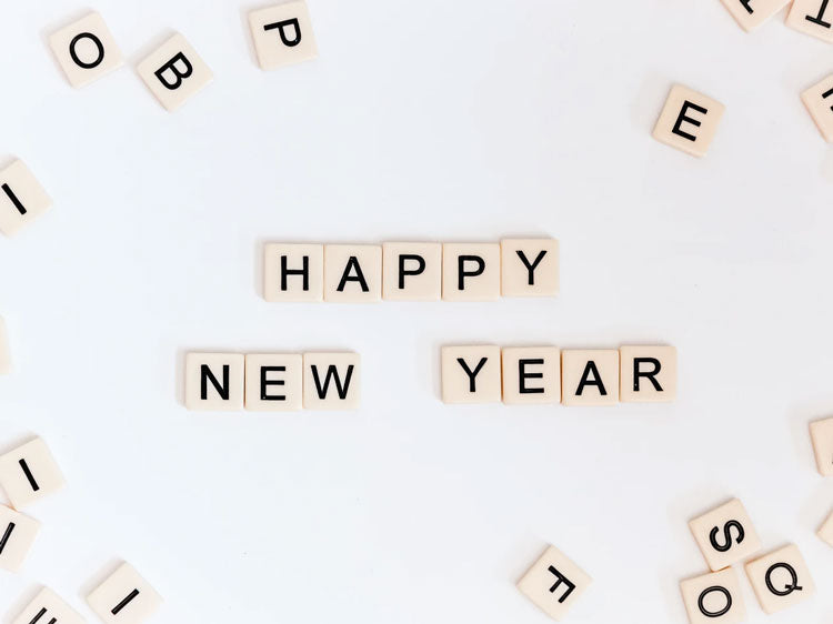 Scrabble tiles that spell out Happy New Year