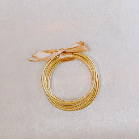 a set of gold elastic bangles