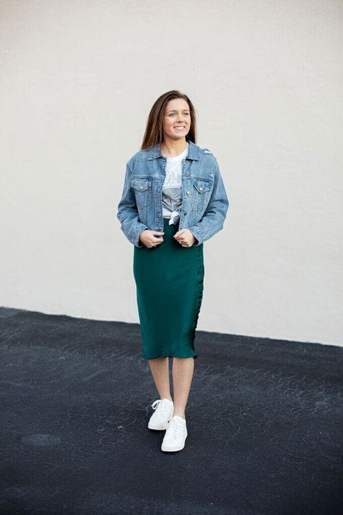 A green satin midi skirt