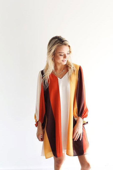 an orange striped dress with puffed sleeves