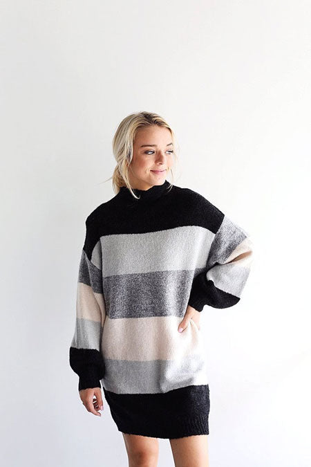 a thick, striped sweater dress