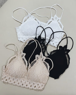 a black, white, and nude lace bralette