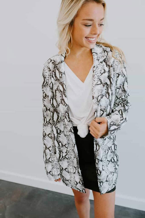 A black and white snakeskin blazer