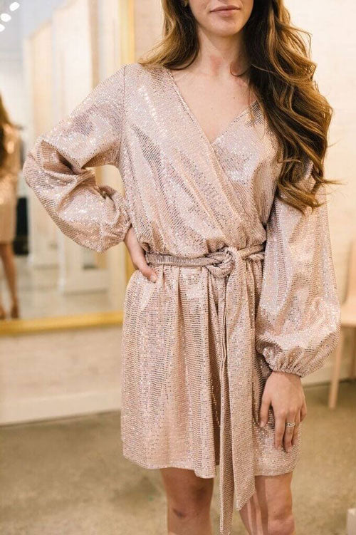 A gold wrap dress covered in sequins