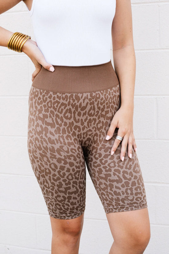 woman in leopard exercise tights