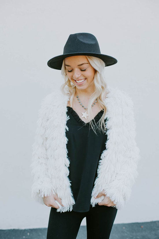 Trendy woman in white shag fur jacket