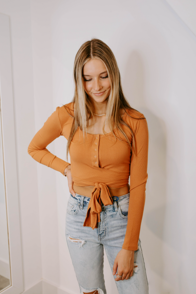 rust button on crop top