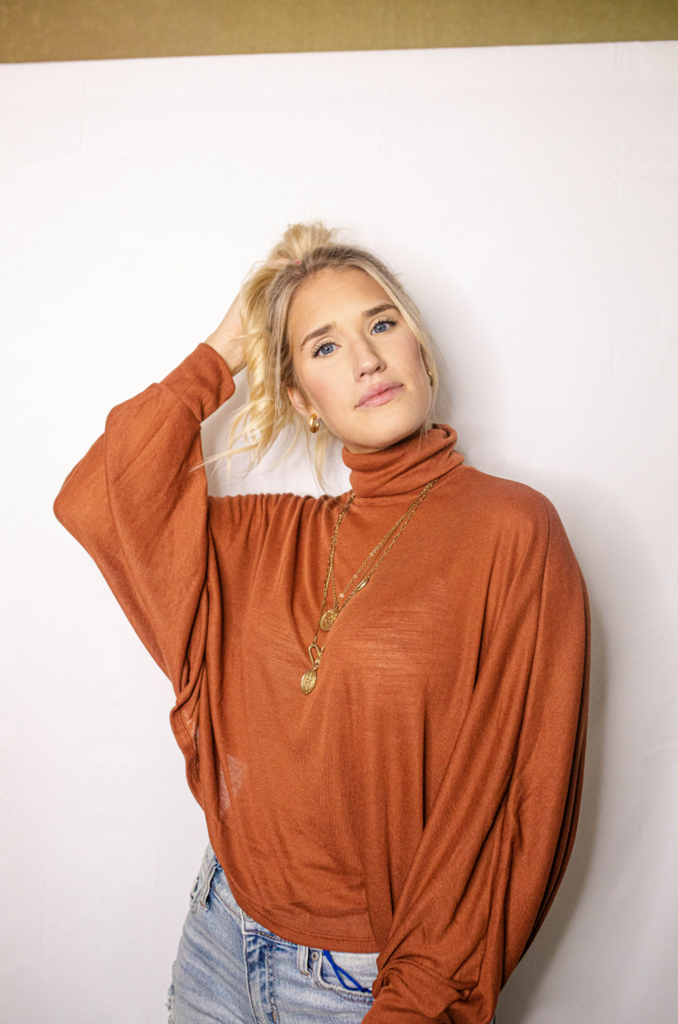 rust turtleneck top