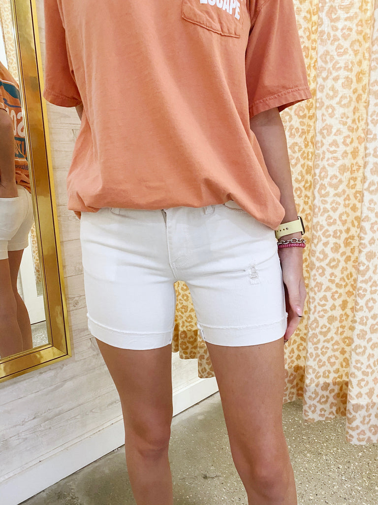 white cuffed shorts