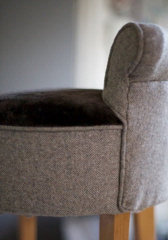 Paif of vintage small chairs coverd in wool and sheepskin upholsted by Kiki Voltaire