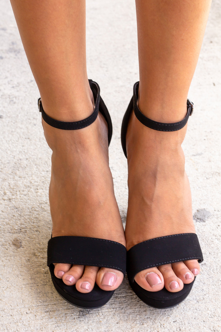 a pair of strappy black open-toe sandals